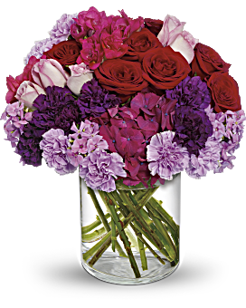 Maybe not as luxurious as a Roman Holiday - but just about! This lavish bouquet of reds, pinks and purples is an exciting way to say congratulations or send your love. Presented in a modern vase, this chic arrangement features a wide variety of fragrant flowers - and only flowers. No greens here! Just lush, luxuriant blooms. Love & Romance Flowers - Roman Holiday - Multi - Flower Delivery By Teleflora