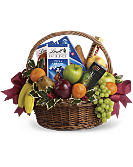 A bountiful Christmas gift basket that will please the health-nut and chocoholic alike! A delicious assortment of gourmet chocolates and fresh fruit are presented in a handled basket and decorated with sprigs of festive holly. It's a mouth-watering choice for a corporate holiday gift, get well gift or thank-you gift. Luxury Bouquets - Fruits And Sweets Christmas Basket - Multi - Flower Delivery By Teleflora