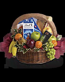 Panier cadeau de sucreries de Noël et de fruits
