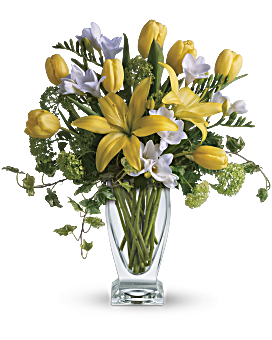 """A rhapsody in yellow. Say """"get well soon"""" or """"have a happy day"""" with this sunny assorted bouquet. Everyone's favorite spring flowers are here - yellow lilies, yellow tulips, with accents of deliciously fragrant freesia flowers. Delivered by a florist in Teleflora's chic Couture Vase. Yellow Bouquets - Spring Rhapsody - Yellow - Flower Delivery By Teleflora"""