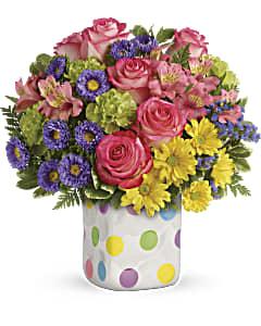 Send a polka dot new baby flower arrangement