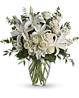 A dreamy bouquet of white sympathy flowers is a comforting reminder of your love. The lush arrangement of soft colors is delivered in a majestic, tall glass vase. June Pearl Bouquets - Dreams From The Heart Bouquet - White - Flower Delivery By Teleflora