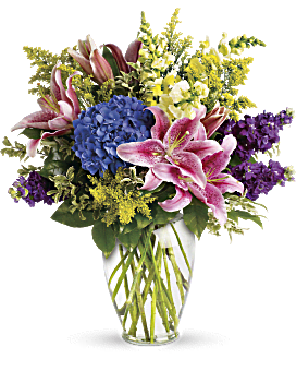 This lovely bouquet of pink lilies, blue hydrangea and other floral favorites is an eloquent expression of caring. The family will be touched by your thoughtfulness. Stock - Love Everlasting Bouquet - Blue - Flower Delivery By Teleflora