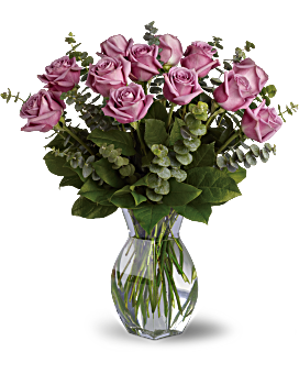 Romantic roses with a lavender twist! A thoughtful selection for the purple-lover in your life, this arrangement of one dozen lavender roses features beautiful spiral eucalyptus and rich green salal. Roses - Lavender Wishes - Dozen Premium Lavender Roses - Green - Flower Delivery By Teleflora