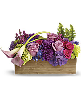 As lush and serene as a tropical sunset, this paradise of feminine blooms is a unique way to send your best wishes. The well-balanced arrangement is both chic and Zen, with its graceful callas, enchanting color palette and modern bamboo container. Spring Flowers - Ticket To Paradise - Multi - Flower Delivery By Teleflora