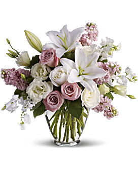 Gorgeous, gorgeous, gorgeous! This lush natural arrangement of royal roses, lilies, lisianthus, sweet pea and stock is stunning in its variety and color palette. Not to mention its fabulous fragrance. Isn't It Romantic - Multi - Flower Delivery By Teleflora