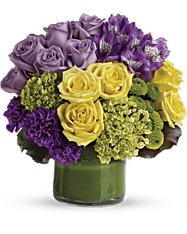 A simply splendid way to surprise someone special! Hand-delivered in a stylish, leaf-wrapped vase, This sophisticated, sunshiny arrangement of hydrangea and roses is an instant pick-me-up. Simply Splendid Bouquet - Multi - Flower Delivery By Teleflora