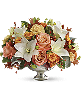 Autumn shimmer! Dress their fall table with this gorgeous, seasonal work of art! Hand-delivered in a stunning mercury glass bowl, this harmonic mix of white lilies and peach roses is sure to make their season memorable. Fall Flowers - Harvest Shimmer Centerpiece - White - Flower Delivery By Teleflora