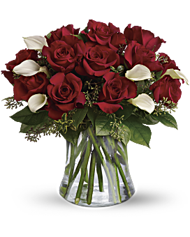 """This bouquet is called """"Be Still My Heart,"""" but her heart won't be still when she sees this wildly romantic bouquet of a dozen red roses and white calla lilies in a sparkling glass vase. It will beat madly, deeply, truly - just for you. Be Still My Heart - Dozen Red Roses - Flower Delivery By Teleflora"""